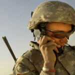 special forces talking on sattelite phone